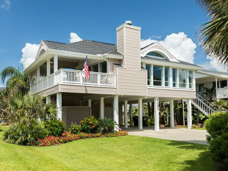 This renovated home affectionately known as 'Spoonbill Manor' is located in the coveted Pirates Beach neighborhood.