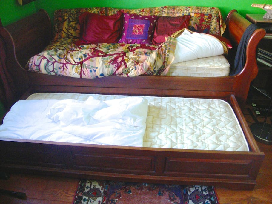 The two single bed. The bottom bed has wheels and can easily be moved to the centre of the room for allowing more space around the other bed