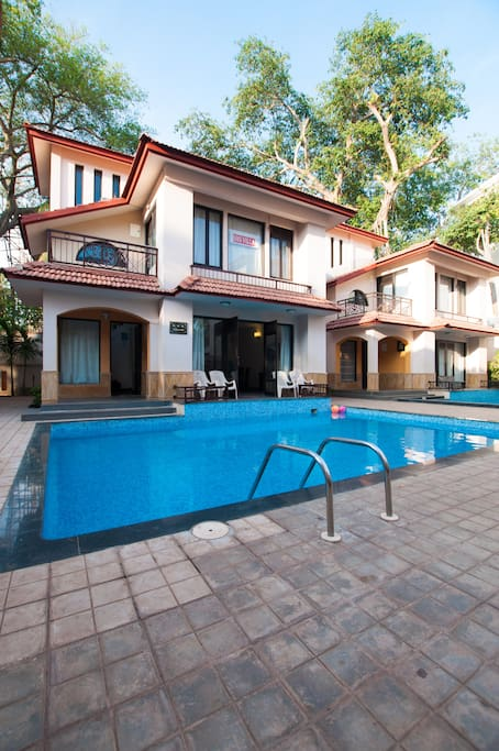 Exterior view of villa with beautiful well maintained private swimming pool
