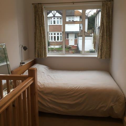 Double bed in upstairs bedroom