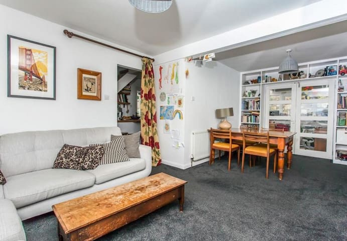 Living room with large sofa, TV with Netflix