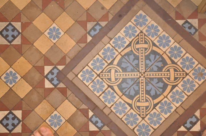 Original tile flooring in the entrance vestibule