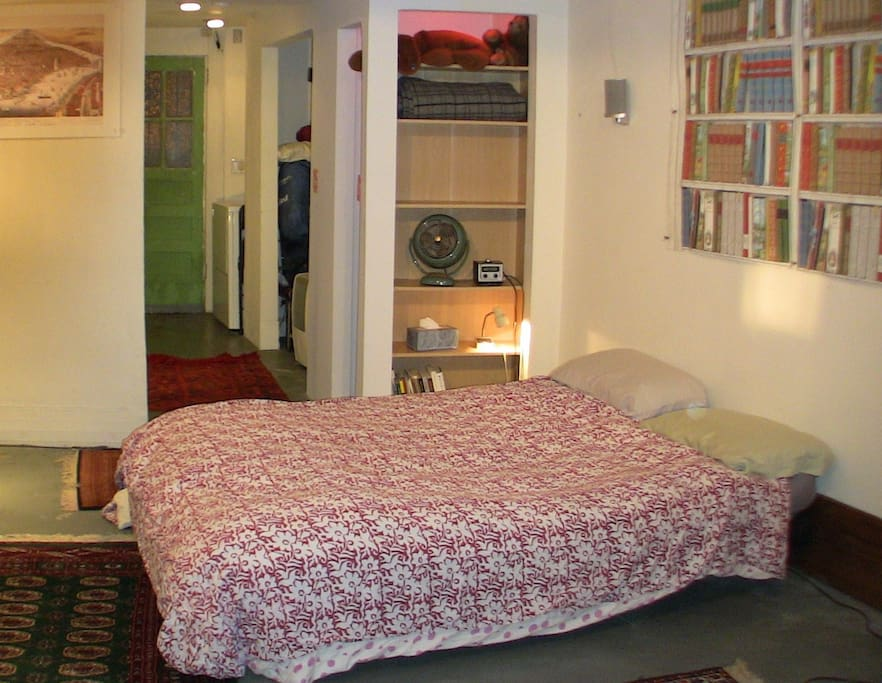 The bed is a confortable queen sized futon placed on a slightly smaller futon and frame.