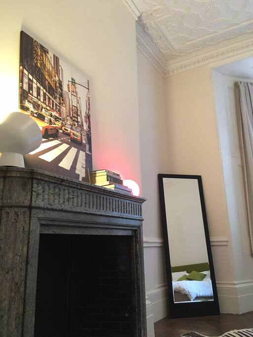 Marble fireplace and full length mirror