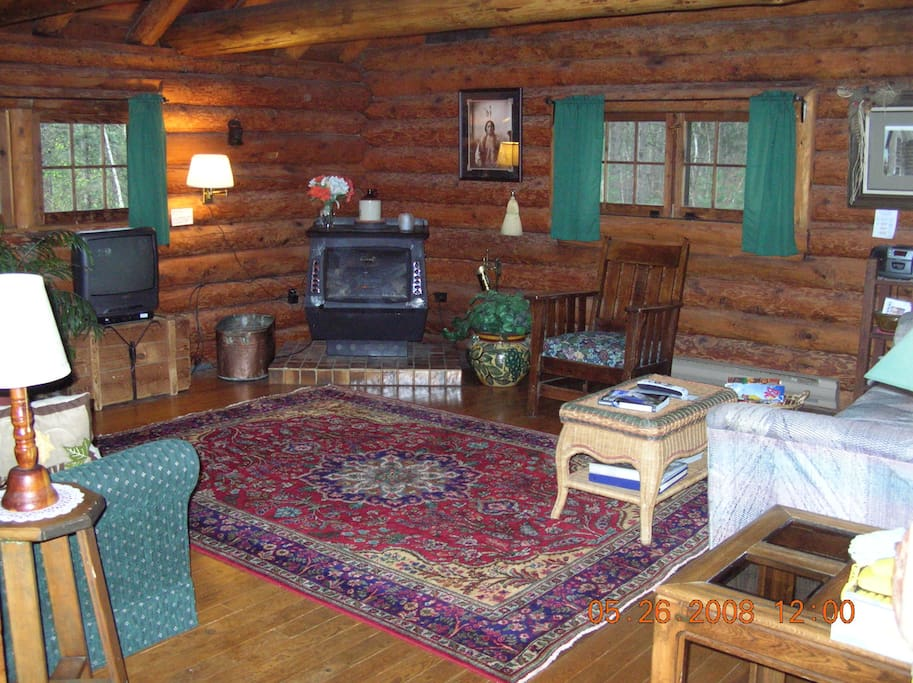 Log cabin is air conditioned for your summer comfort and baseboard heaters in every room for cooler days.