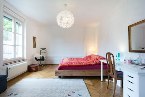 A big and beautiful room with two windows and lots of natural light. Bed is huge and comfortable.