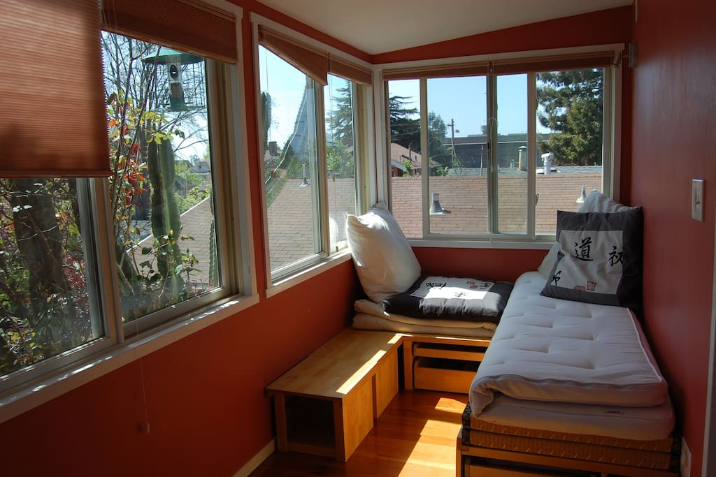 Garden guest room with a relaxation bench that transforms into a full sized tatami bed.