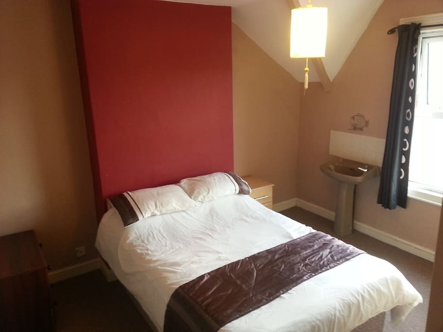 Room 1 - Double bed, mini sink with cold running water. Wifi booster. Rear facing quieter room.