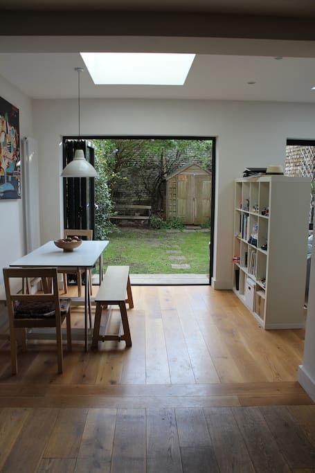 Bright dining area with access into the garden through the fulling opening doors.