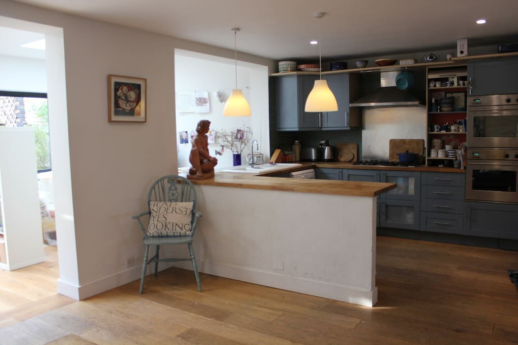 Kitchen area, wooden worktops, gas cooker, dishwasher, microwave, toaster, kettle and all the pots, pans and things you need.