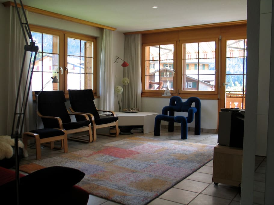Living room with modern furniture and many windows