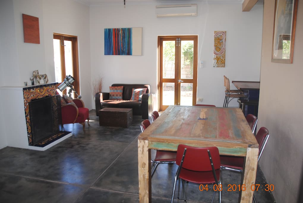 dining room/ lounge room one which overlooks pool and backyard.