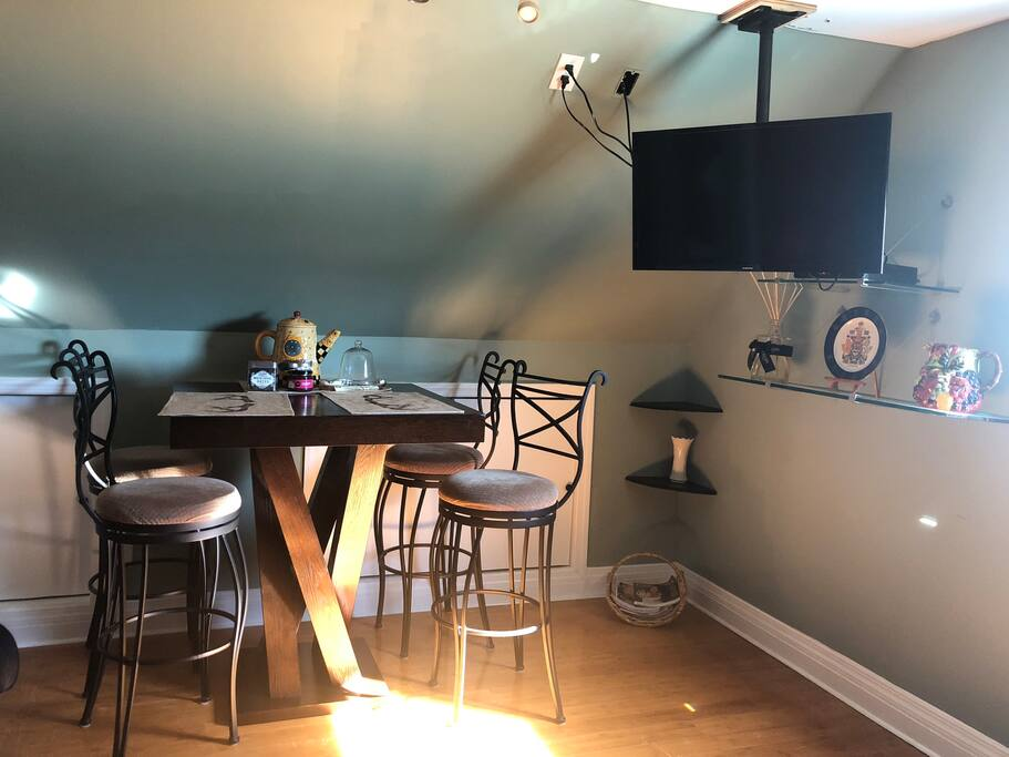 Share Dinning table with hanging TV