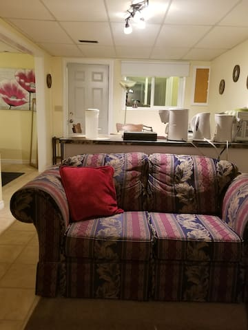 Love seat , one of the couches for watching TV and relaxing