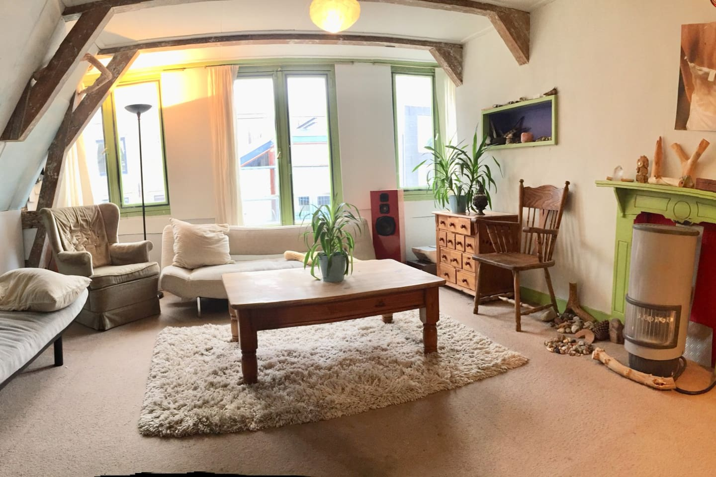 Our cozy living room looks out onto the cutest shopping street. It has a single futon bed, and a couch which folds down for sleeping.