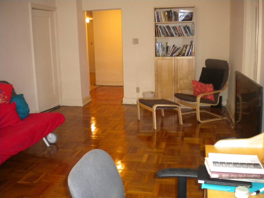 living room. includes tv w/ dvd player (sorry, no cable), internet, queen size sofa bed, desk, small rocking chair, reclined chair w/ small ottoman, adjustable radiator