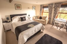 Bedroom  with stunning views of the Countryside. With King size bed, settee, dining table and Smart TV