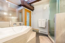 Luxury Master ensuite with steam shower and soaker tub