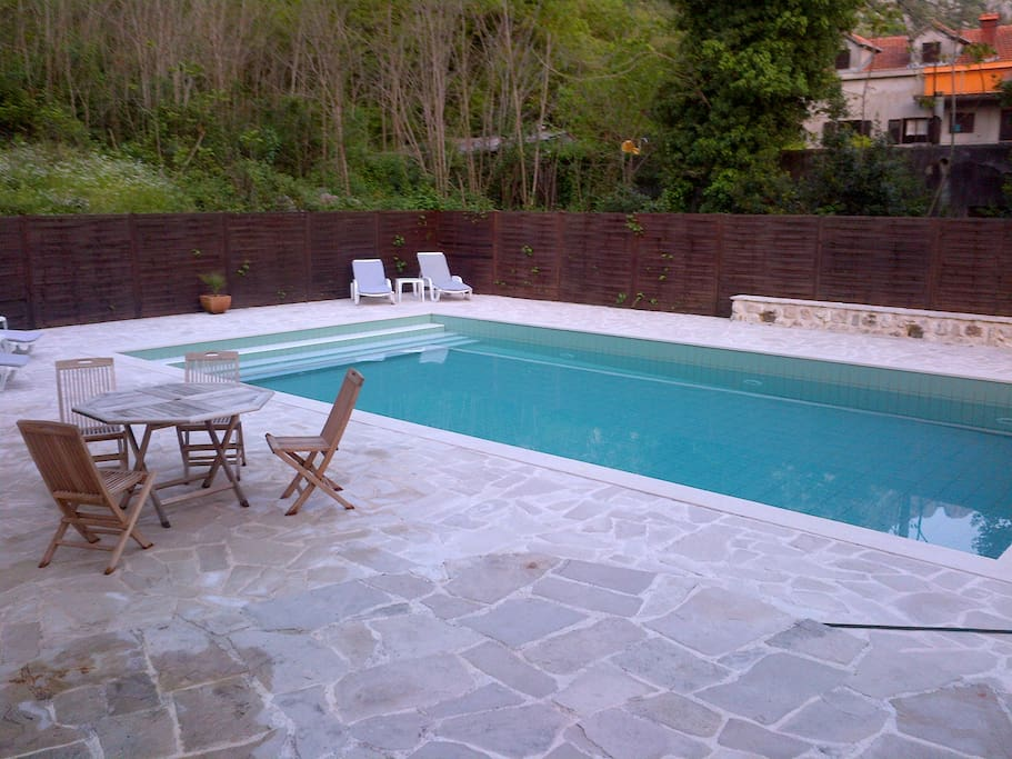 Large private swimming pool in the back yard