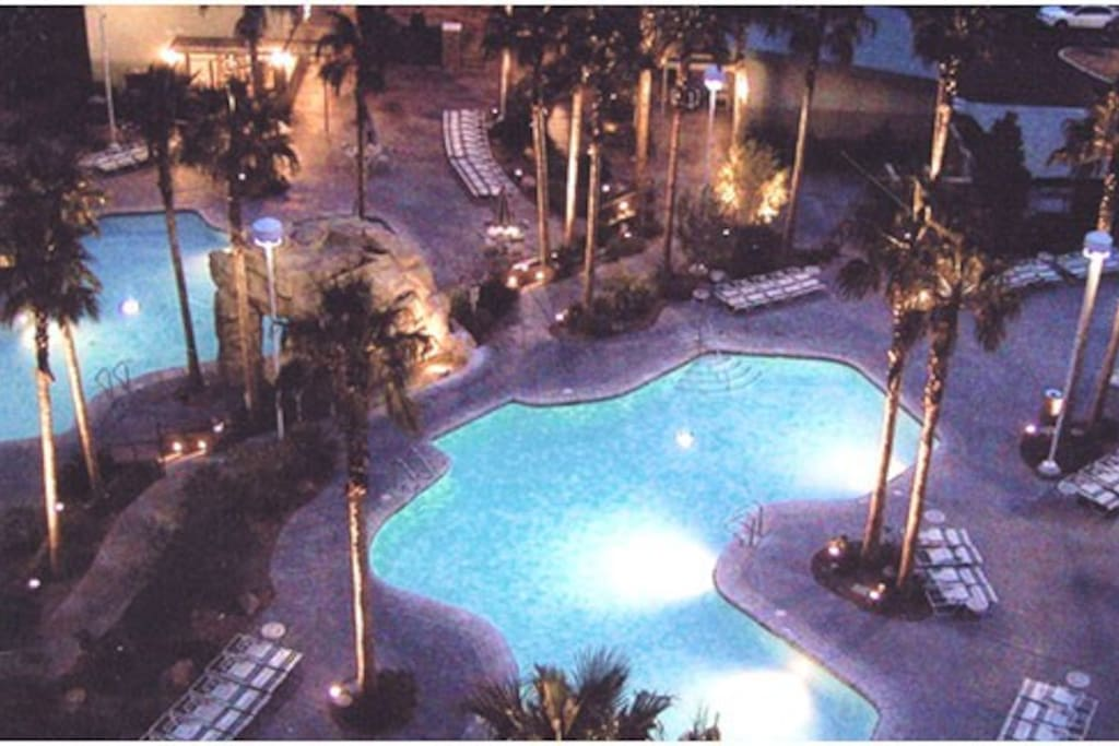 night view of a couple of the pools