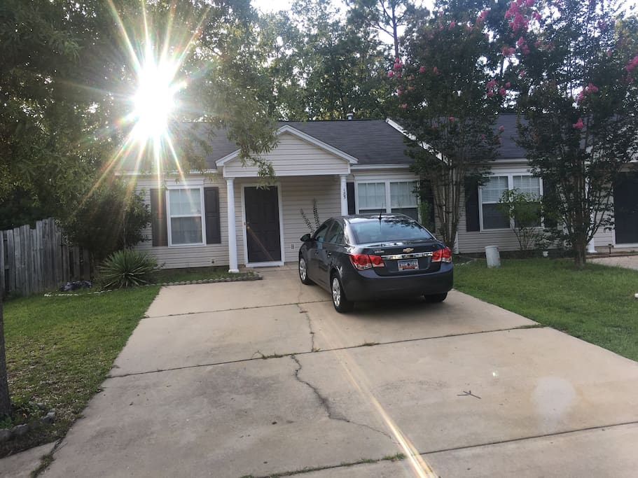 Front of house with 2 car (up to 4) driveway
