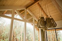 A hand crafted chandelier dangles from the vaulted ceiling