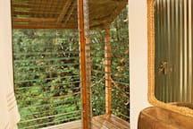 Bathe in Hawaiian rain water sustainably harvested from the roof of the treehouse