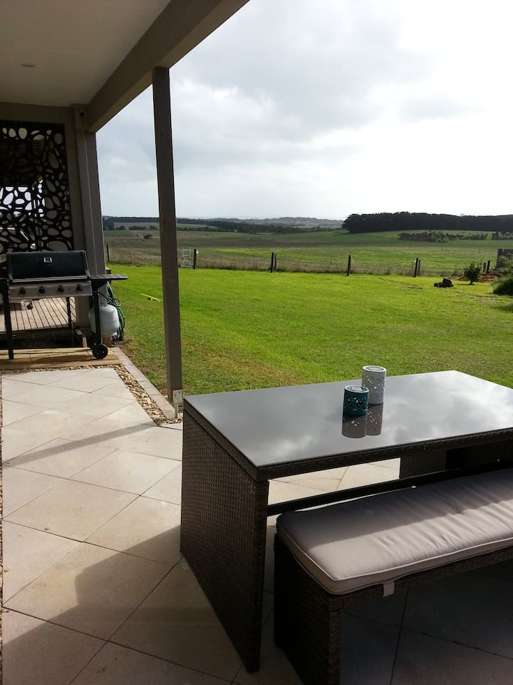 Paved area with gas BBQ and outdoor setting,