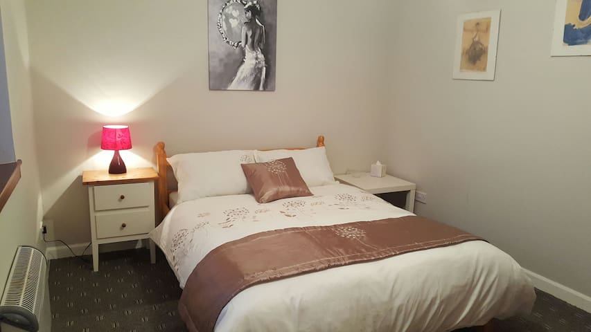 Large double bedroom, and we supply two comfortable single camp beds and a travel cot for infants