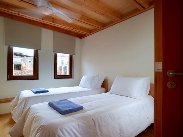 Bedroom with two singles beds or one king size double bed. Enjoy the high deluxe quality of those unique mattresses. Have a great sleep! Dorotheou House  in Chania Old town!