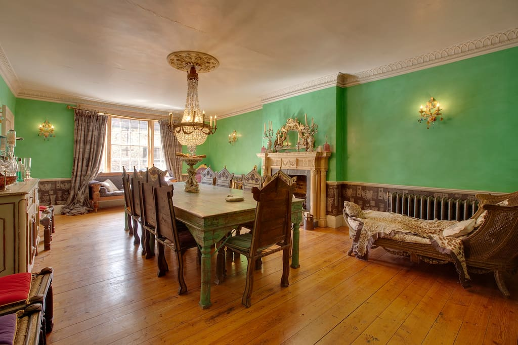 Magnificent formal dining room (seats 14) with antiques and real fire