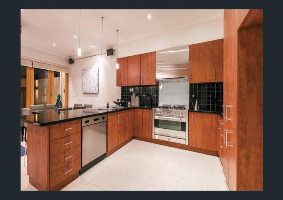 Kitchen, gas stove, coffee maker, dishwasher