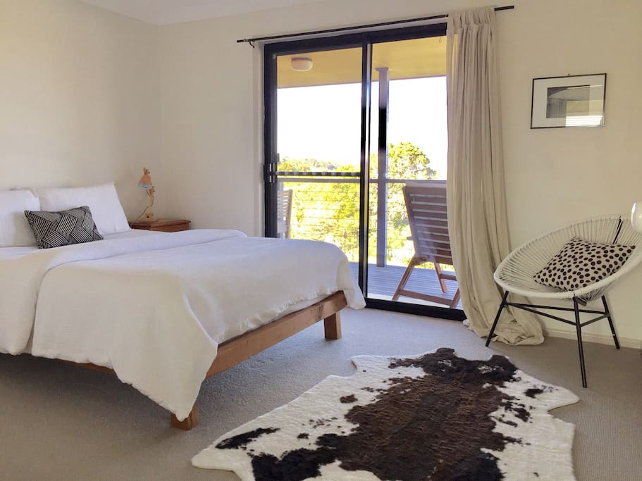 Master bedroom with queen bed with hotel quality 100% cotton linen. Direct access to the deck for your morning cuppa.
