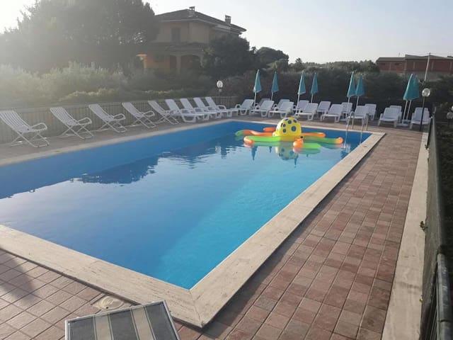 Propriété avec accès piscine