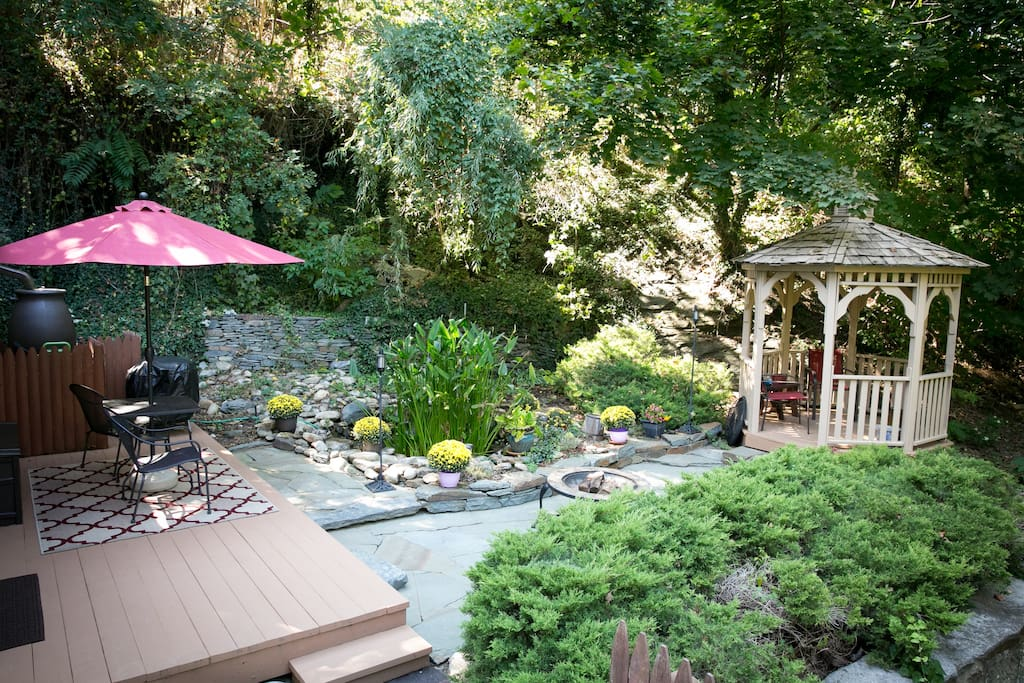 Private side yard with deck, fish pond and gazebo