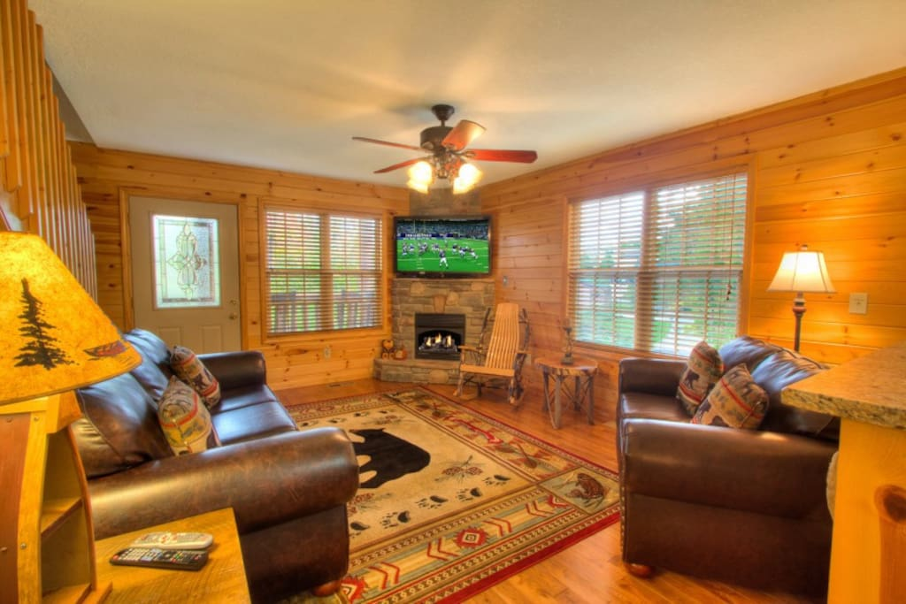 Open floor plan with seating for six, including an Amish rocker.