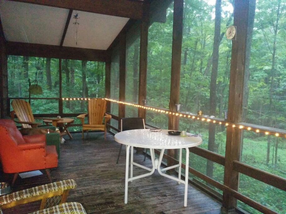 Private screened in porch with seating , table for cards etc