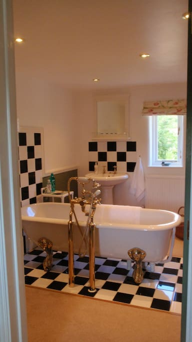 Ensuite bathroom with sumptuous roll-top bath