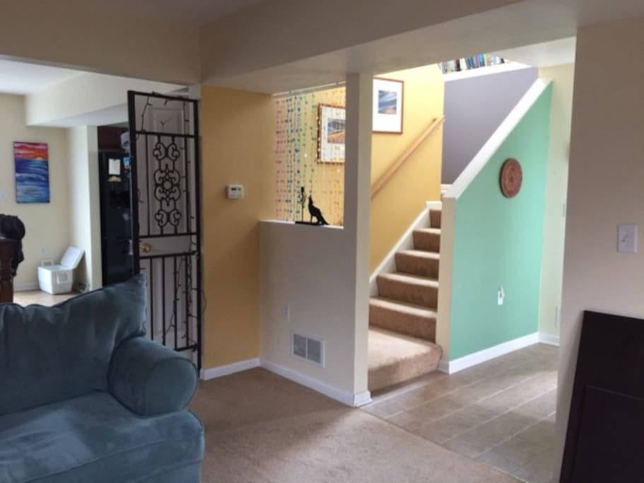 Front door and stairs to shared living room area.