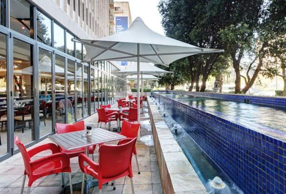 Outdoor terrace on ground floor of the hotel building