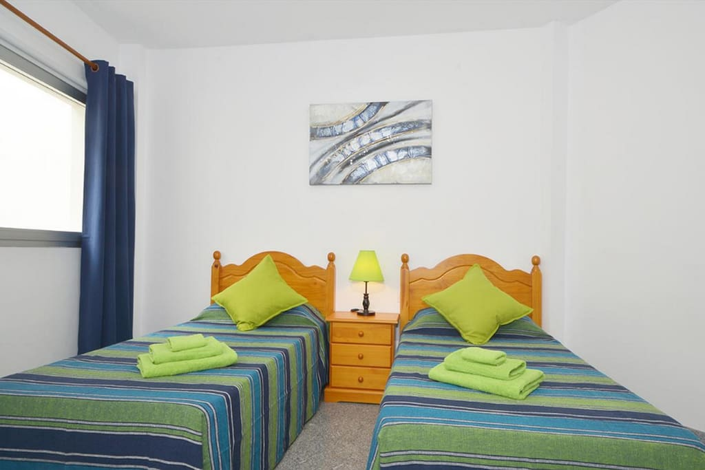 Twin Bedroom with Large Built-In Wardrobes