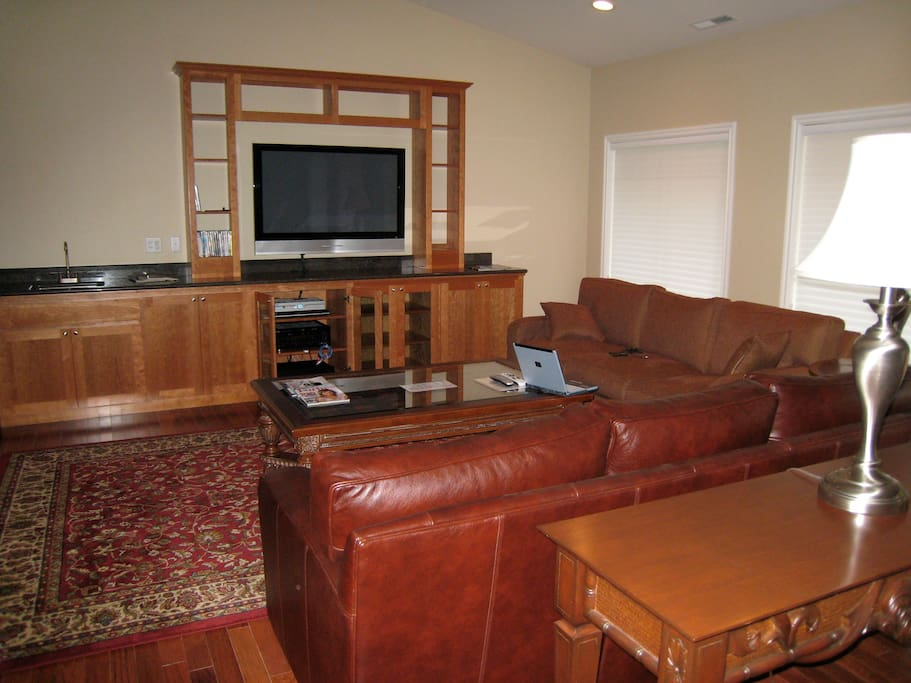 Large TV and gathering area.  The back deck is directly off the great room.