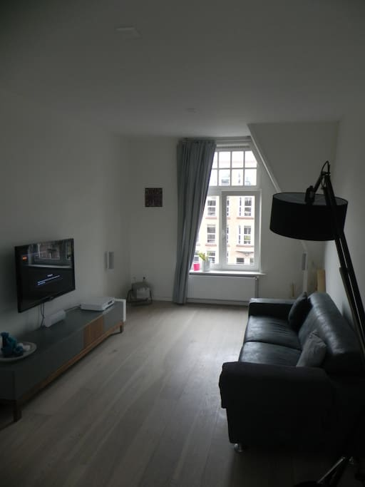 Lounge area - flooded with light and complete with Plasma TV, Cable & top surround sound music system (including Airplay).