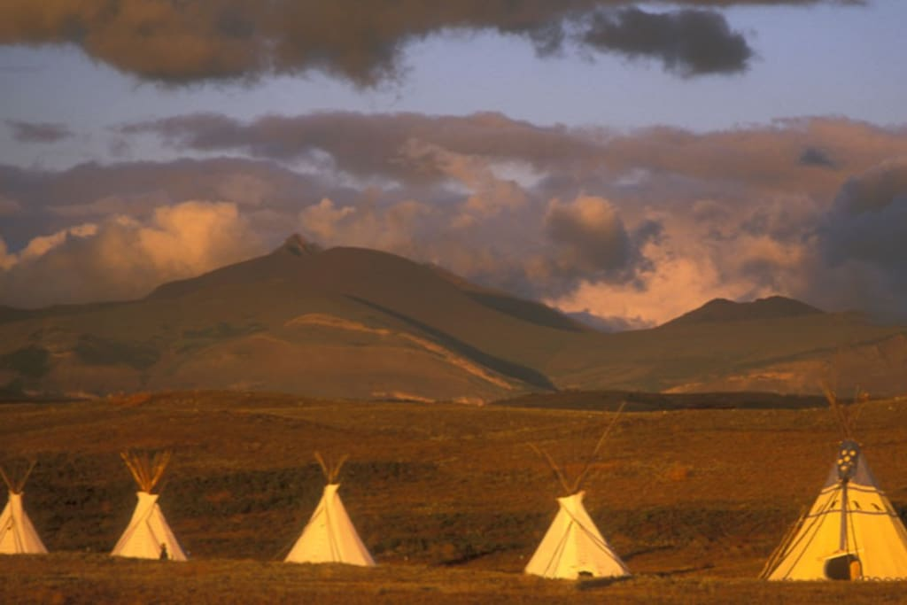 Our Tipi Village is located fifteen miles east of Glacier National Park on the Blackfeet Indian Reservation.
