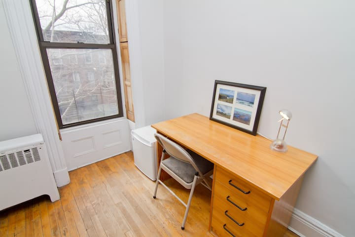 oak desk and mini fridge