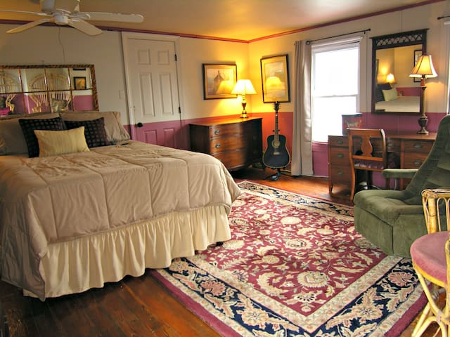 Large Bedroom with Refinished Old Pine Floors