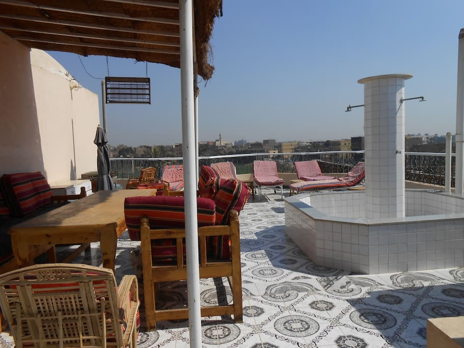 Roof terrace with sunbeds, large shower and one of the seating areas.