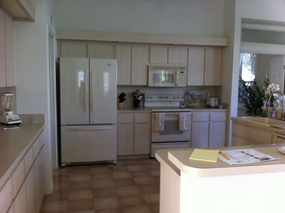 Fully equipped kitchen; laundry facilities in garage.