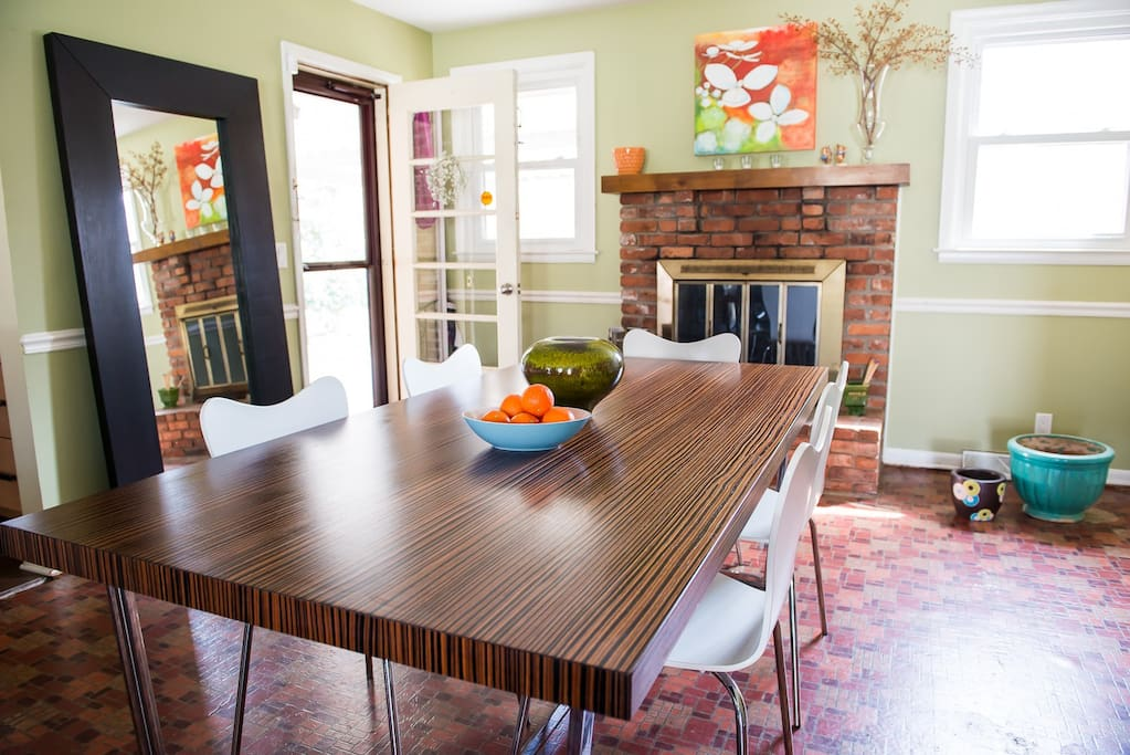 Dining room with wood-burning fireplace.
