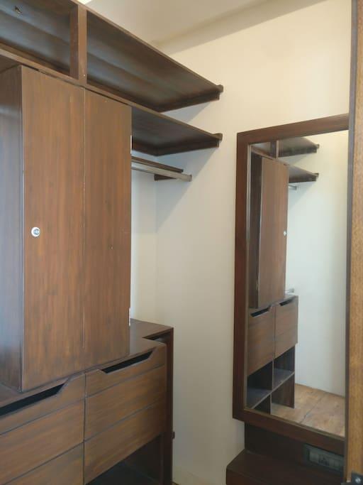 lavish walk-in wardrobe with large dressing table